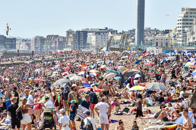 Brighton UK 29th June 2019 -  Brighton beach is packed as Britain swelters in the heatwave sunshine with some areas of the south east forecast to reach over 30 degrees  . Credit : Simon Dack / Alamy Live News.
