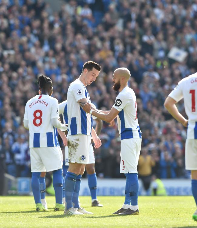 Bruno hands over the captain's armband to Lewis Dunk in Albion's last game of the season after coming off in his final appearance for the club