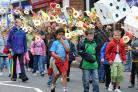 UCKFIELD FESTIVAL 10TH ANNIVERSARY - THE PROCESSION MAKES ITS WAY DOWN THE HIGH STREET