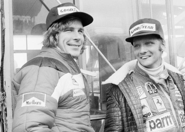 FILE - In this Oct. 24, 1976, file photo, Austrian auto racer Niki Lauda, right, defending champion in world driving, and James Hunt, of Britain, look at the rain before the start of the Japan Grand Prix Formula One auto race at Fuji International Speedwa