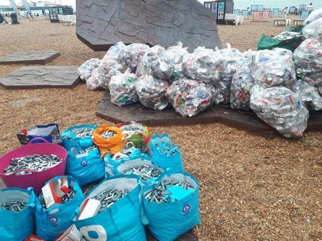 Rubbish and laughing gas cannisters on Brighton beach after Pride