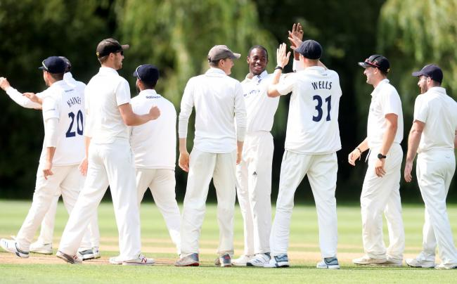 Jofra Archer,  centre,  is congratulated as he takes another wicket for Sussex Seconds