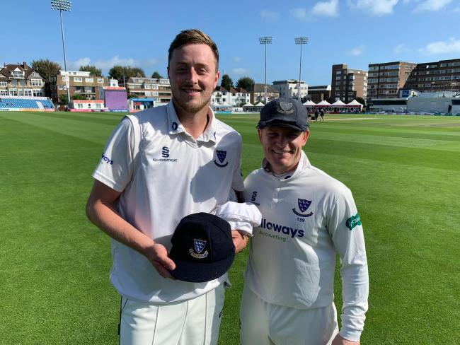 Ollie Robinson receives his county cap from Ben Brown. Picture: Sussex Cricket
