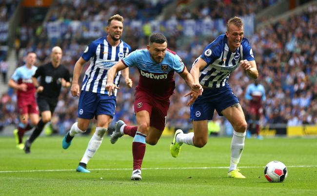 Dan Burn on the run with West Ham's Robert Snodgrass