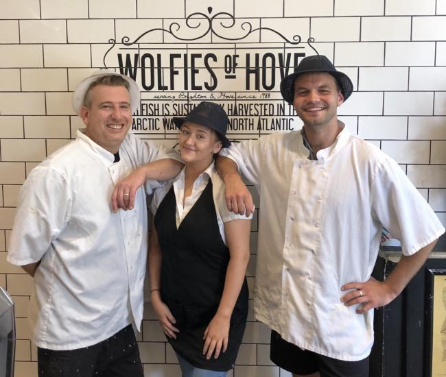 Wolfies co-owner Danny Keston with staff members Olivia Gamble and Ryan Sutton