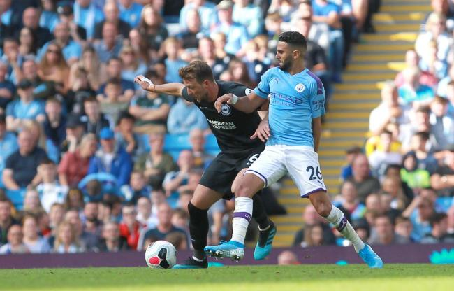 Midfielder Dale Stephens shields the ball from Manchester City's Mahrez in Albion's last game before the international break. Picture: Richard Parkes.