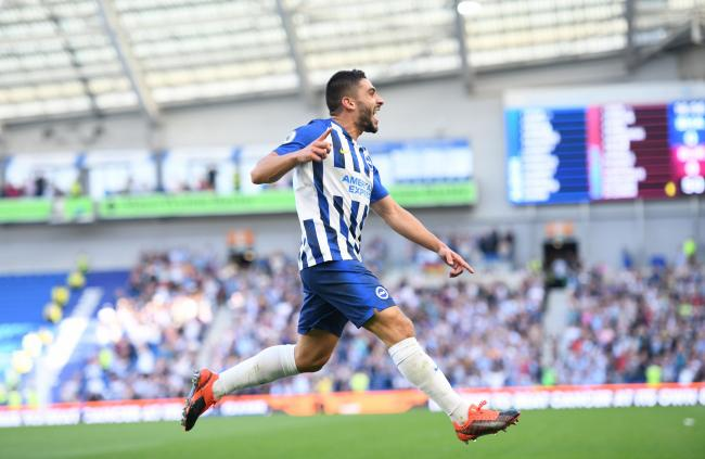 Neal Maupay celebrates after scoring at the Amex