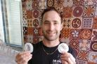 Free condoms given away at Brighton hummus and pitta bar Humpit, with founder Jonathan Phillips