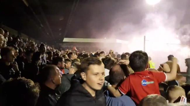 Crawley fans celebrate behind the goal after the shootout.
