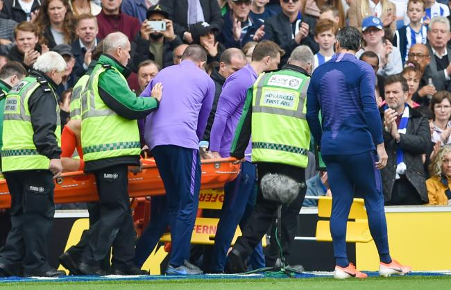 Hugo Lloris is carried towards the tunnel on a stretcher.