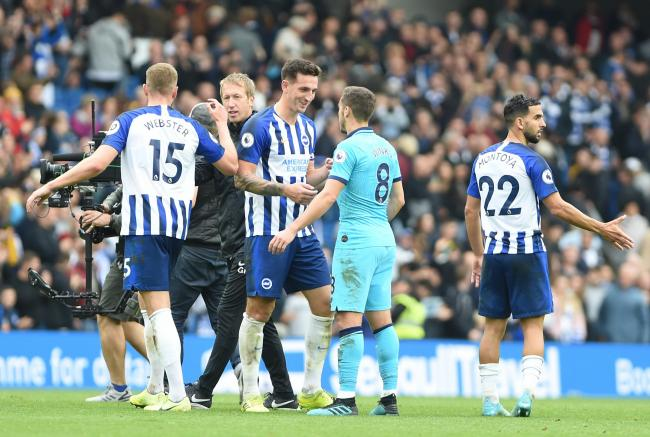 The impressive Lewis Dunk talks to Harry Winks at full-time