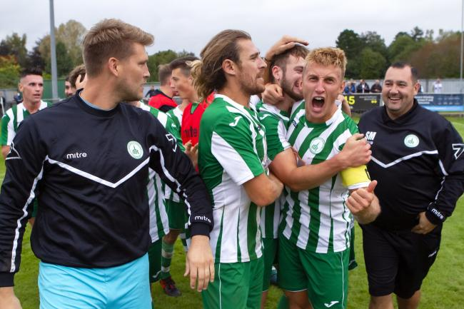 Chichester's players celebrate beating Enfield on Saturday. Picture: Neil Holmes