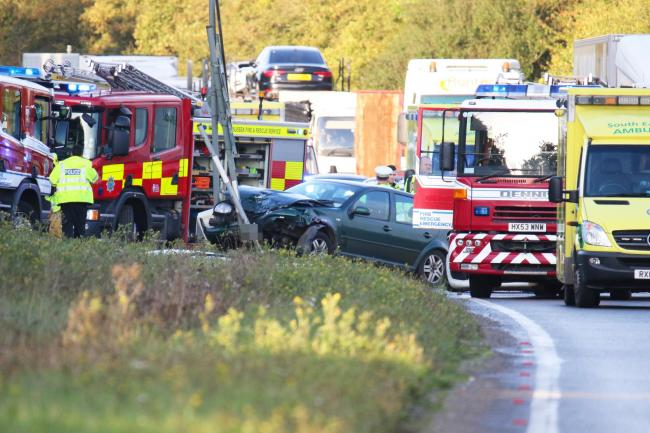 Police, firefighters and ambulance crews at the scene of the crash on the A24 at Dial Post, 08/10/2019