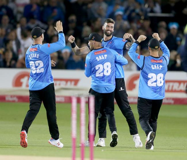 Reece Topley, centre,  helped Sussex Sharks to the knockout stages in the Vitality Blast