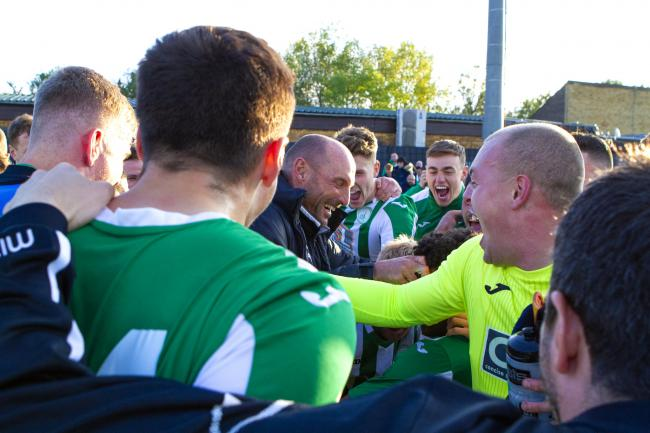 Miles Rutherford celebrates with Chichester City players on Saturday. Picture: Neil Holmes
