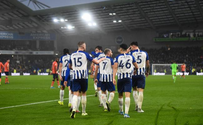 Albion celebrate their winner against Everton amid the gathering gloom at the Amex. Picture: Simon Dack