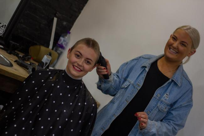 Jodie having her hair shaved