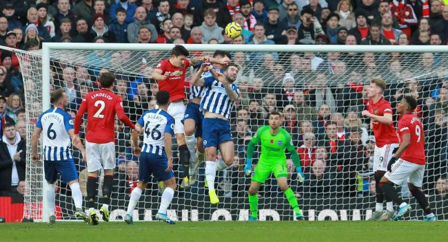 Shane Duffy and Lewis Dunk have an aerial duel with Harry Maguire. Picture: Richard Parkes.