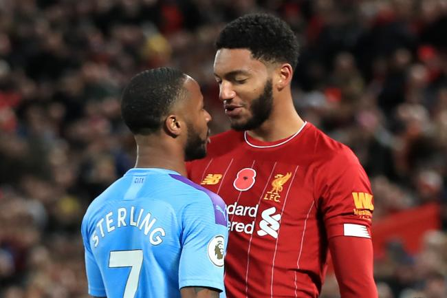 Liverpool's Joe Gomez (right) and Manchester City's Raheem Sterling