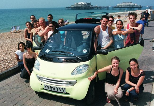 A brave group attempted to squeeze themselves into a Smart Car in 2001