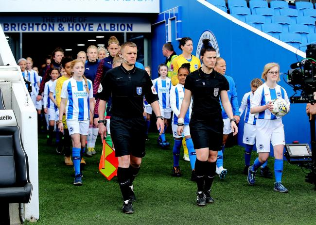 Dani Bowman leads Albion out at the Amex last season