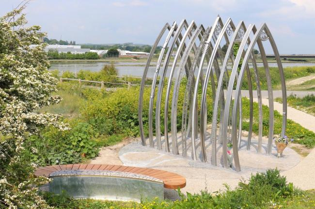 A memorial bench and 11 individually crafted arches sit alongside the River Audr in Shoreham
