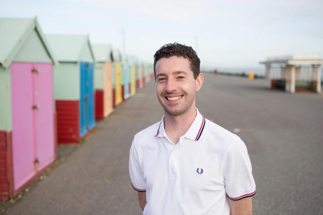 Councillor Robert Nemeth smiling after his beach hut victory