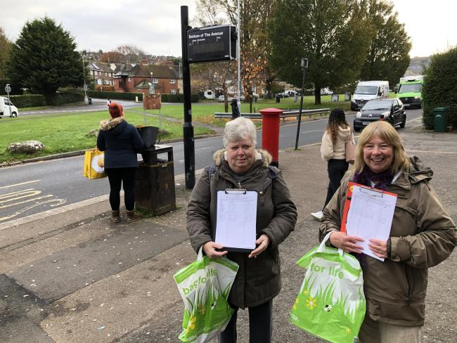 Brenda and Shirley with their petition at the site of the old bus shelter