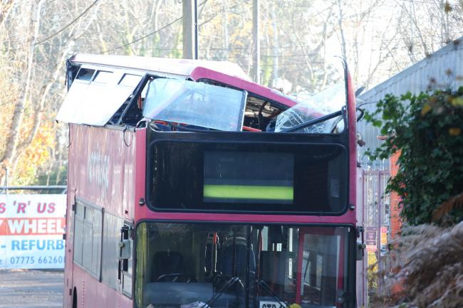 Top floor of double decker bus destroyed in Hassocks 'accident' . Picture by Simon Fenton