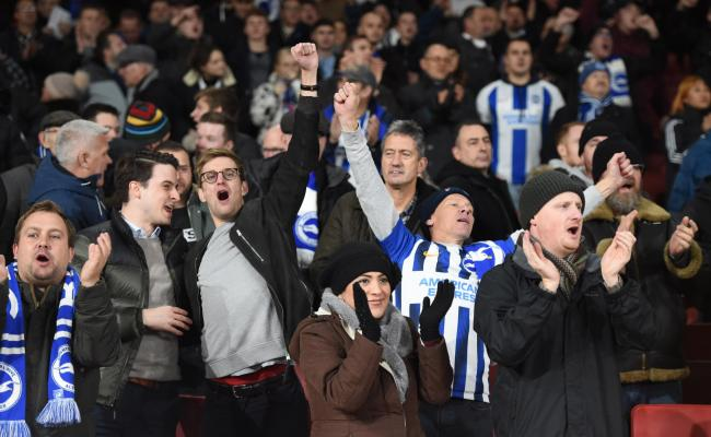 Albion fans celebrate at the Emirates last night. Picture by Simon Dack