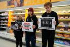 MANDATORY CREDIT REQUIRED..Handout photo dated 11/12/19 issued by Direct Action Everywhere (DxE) of demonstrators holding a protest in the meat aisle in a branch of Sainsbury's in Brighton, East Sussex. PA Photo. Issue date: Thursday December 12, 2019