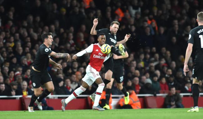Dale Stephens battles for the ball with Joe Willock of Arsenal in the 2-1 win at the Emirates. Picture: Simon Dack.