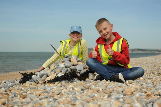 Youngsters can enjoy learning at the beach with Sussex Wildife Trust. Picture by Miles Davies