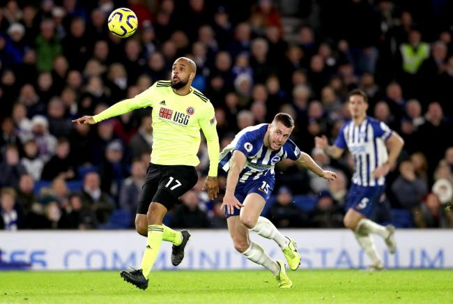 Sheffield United's David McGoldrick (left) gets away from Albion's Adam Webster