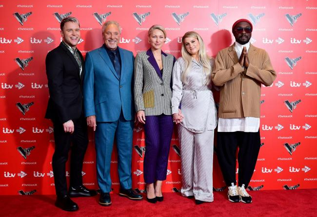 16/12/19 PA File Photo of (L-R) Olly Murs, Sir Tom Jones, Emma Willis, Meghan Trainor and will.i.am attending the Voice UK Series 9 launch held at The Soho Hotel, London. See PA Feature SHOWBIZ TV The Voice UK. Picture credit should read: Ian West/PA Phot