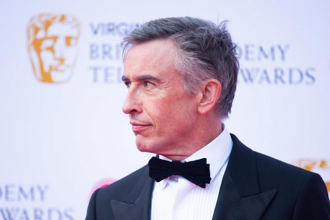 Steve Coogan, pictured attending the Virgin Media BAFTA TV awards, has hit back after national newspapers criticised him for having 'furloughed his gardener and housekeeper'
