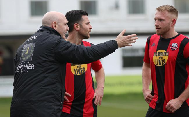 Hugo Langton (left) talking to skipper James Hammond (right) during their game against Kingstonian. Picture: James Boyes