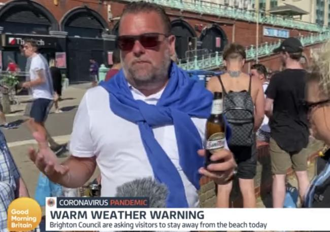 A man drinking beers on Brighton beach says lockdown measures need to be stricter