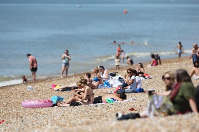 Access to Brighton beach has been restricted after 'flocks' of visitors descended to the seaside