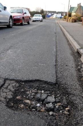 DANGER: Cracks have started to appear across the county, including in King's Road, Lancing