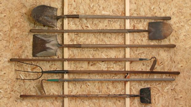 The Argus: Get heavy tools, rakes, shovels, etc., off the floor using utility hooks or, even, nails. Credit: Getty Images / Twoellis