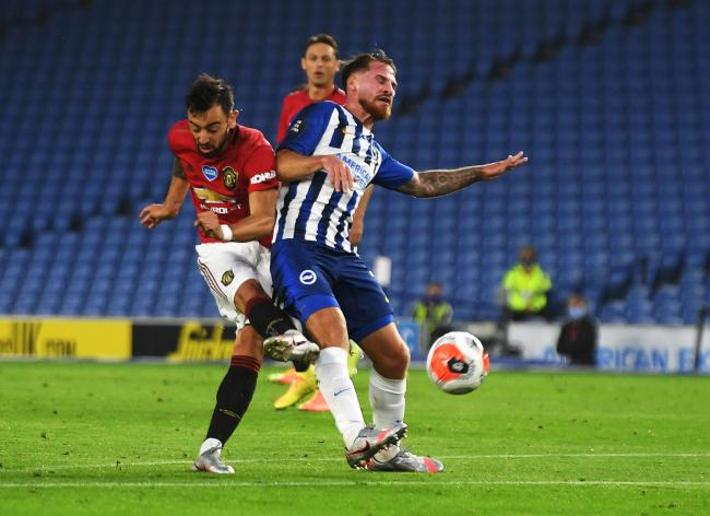 Bruno Fernandes's shot flicks off Alexis Mac Allister for United's second goal at the Amex last night