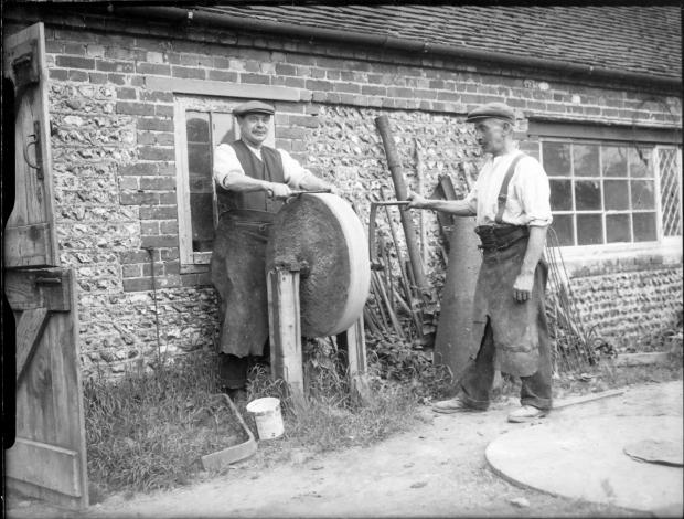 The Argus: Sharpening farm tools on the South Downs in 1937. Photo: East Sussex Record Office/The Keep. ARG/3/1523X