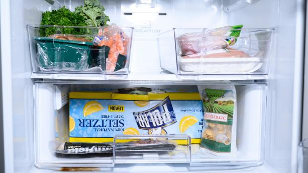 The Argus: We lined the bottom of the fridge bins with kitchen towel—you can also use fridge mats. Credit: Reviewed / Betsey Goldwasser