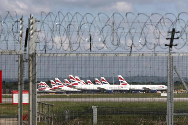 British Airways planes grounded due to the coronavirus outbreak are parked at Gatwick Airport in Sussex..