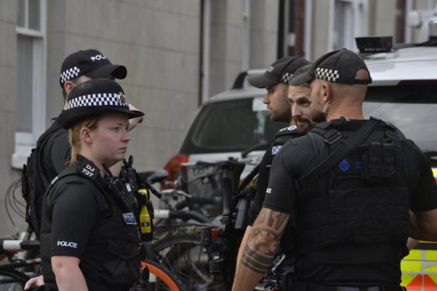 The Argus: Officers at the scene in Western Road, Hove, yesterday. Photo: The East Sussaxon