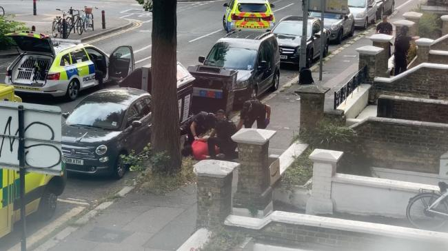 Armed police arrested a man in Cromwell Road yesterday after reports of a gun