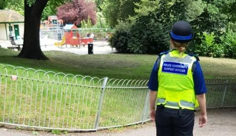 A police community support officer on patrol in Queens Park, Brighton