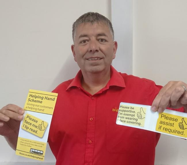 Customer Service Advisor Mark Evans with one of the Helping Hand face covering exemption cards