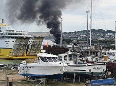 Smoke is pouring into the sky at a fire in Newhaven Credit Liz Boorman